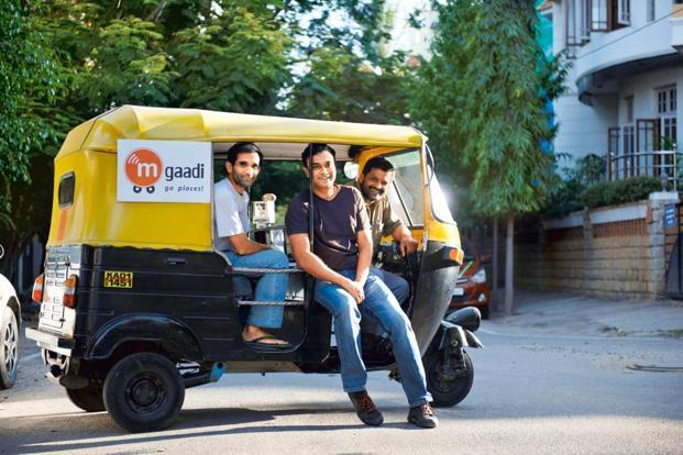 Vishy Kuruganti (extreme left) and  Solomon Prakash (centre), co-founders of mGaadi, want to make it easier for commuters to find transport. Photo: Aniruddha Chowdhury/Mint
